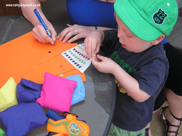 toddler peeling stickers from a sheet