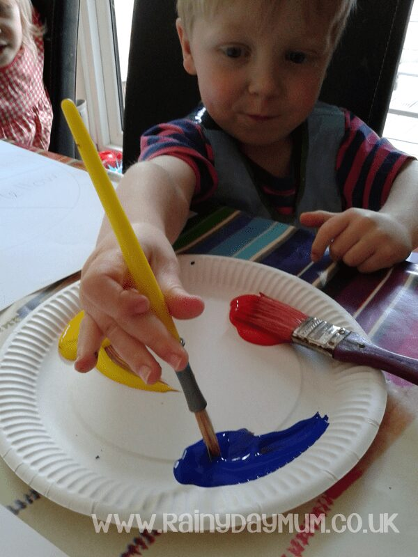 Painting with only primary colours creating a color wheel with the Virtual Book Club for Kids