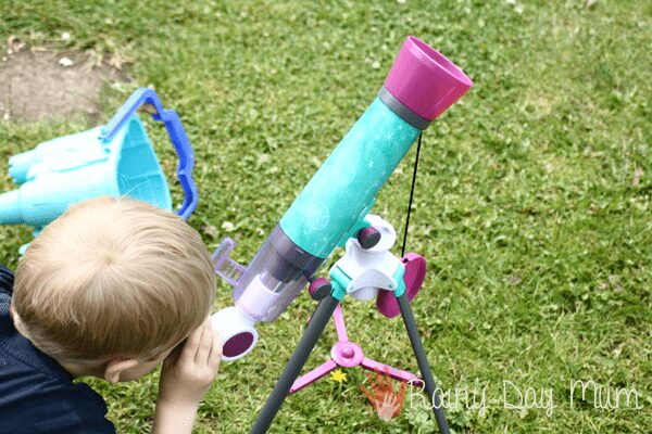 child using a child friendly telescope to explore the night sky