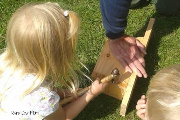 child making a nest box in the summer