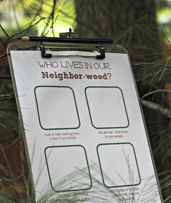 forest scavenger activity sheet on a clipboard to complete on a woodland walk with toddlers