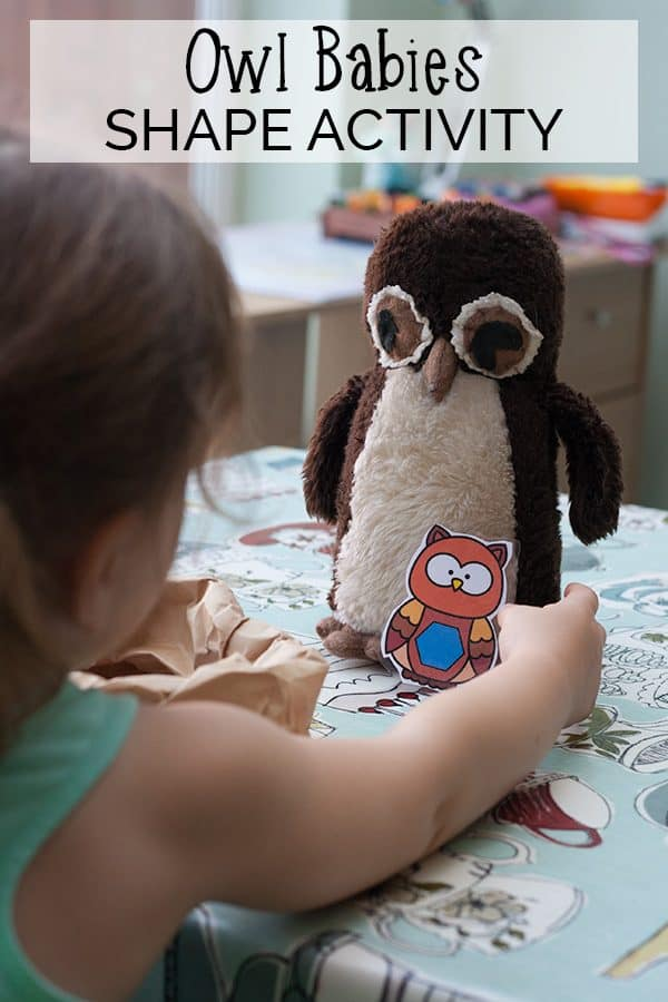 Preschooler playing the printable owl maths game working on shape and colour recognition