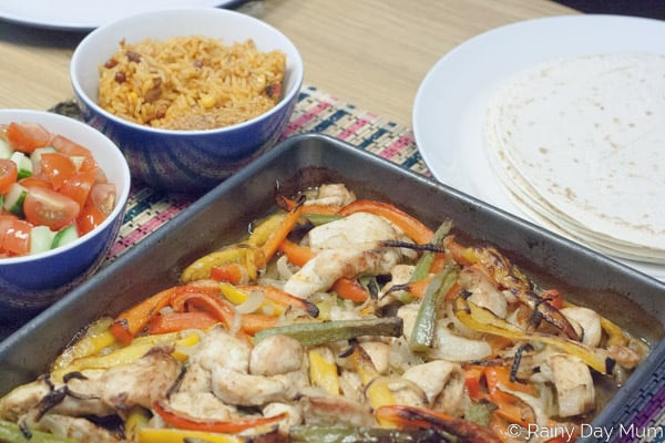 Simple to make ahead chicken fajitas recipe that makes a perfect easy mid-week family meal for everyone to enjoy. Straight from the oven to table.