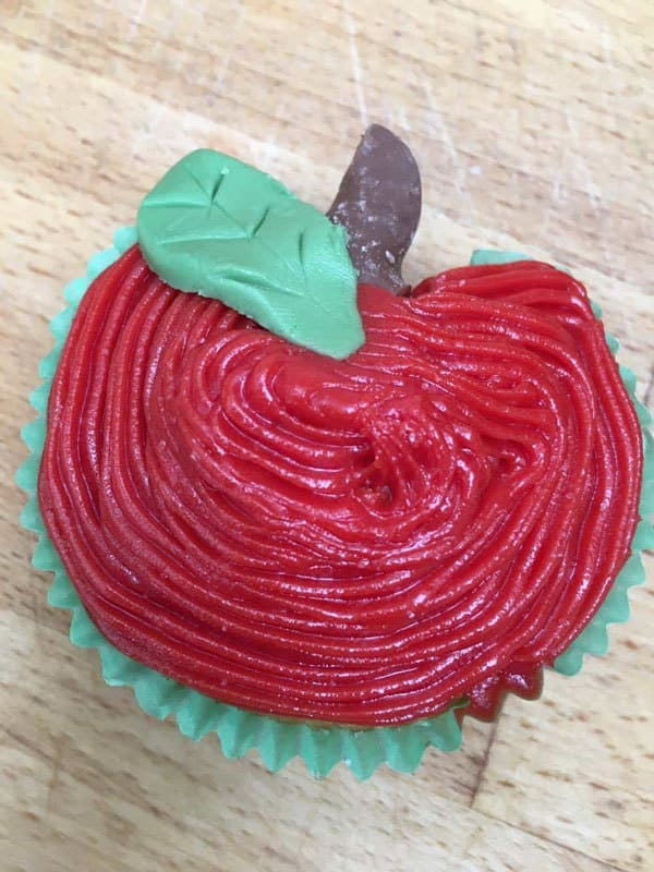 Easy to make even with no cake decorating experience apple cupcakes ideal for school cake sales, class treats or back to school parties.