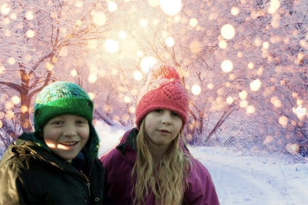 So, this year, we took a very muddy walk across the field and captured a fantastic picture of the kids sitting by the rail track. They both wanted something wintry to send, so we switched out the railway and instead used a snowy background for the thank you cards.