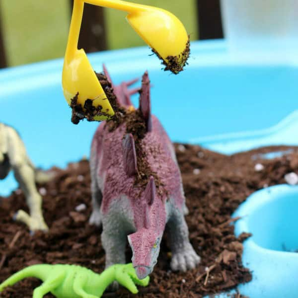 Pretend play with dinosaurs inspired by the book Dinosaur Farm
