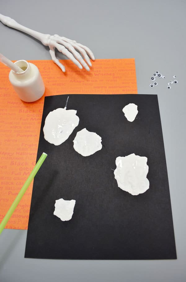 Ghosts shapes made by paint blown around with a straw