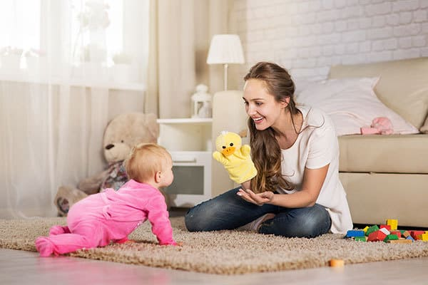 Singing silly rhymes and using puppets with your 8-month-old baby