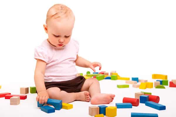 Baby Girl Playing with Blocks on the floor