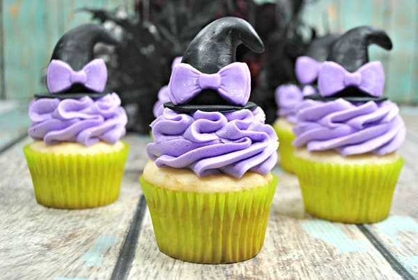 little witch halloween party cupcakes with pretty purple bows