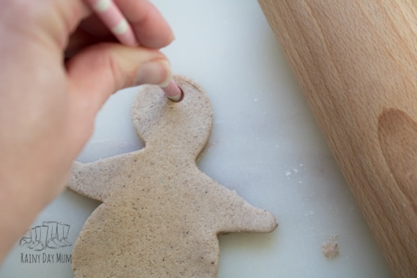 Adding a straw to make the Christmas salt dough ornaments easy to hang on the tree