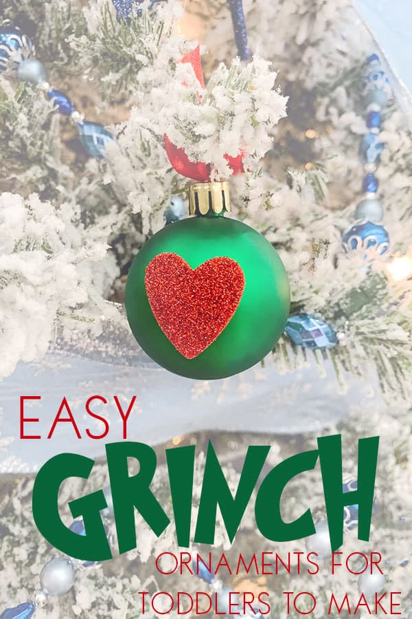 Image of Grinch Heart Ornaments hanging on a Christmas Tree to make with toddlers