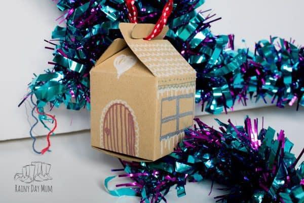papercraft gingerbread house for kids to make and decorate a simple christmas craft that they can do