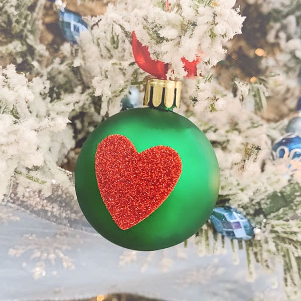 Quick and easy toddler craft inspired by How the Grinch Stole Christmas to create baubles for the tree