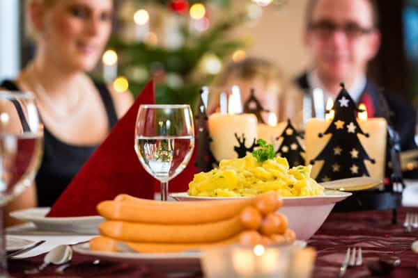 Traditional family recipes served in German on Christmas Eve with the Family around the table celebrating