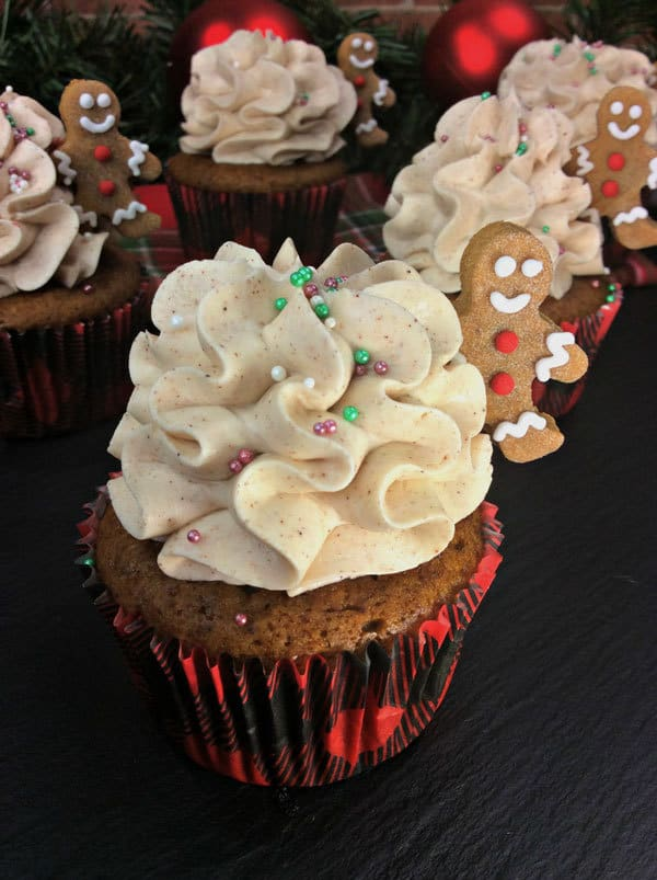 Delicious Cinnamon Frosting with mini Gingerbread Men on Gingerbread Cupcakes for Christmas in Tartan Cupcake Cases