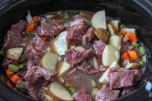 beef stew cooking in the slow cooker. Using diced beef from the butchers for a hearty family meal for rainy days