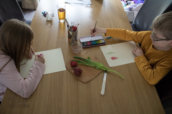 child using watercolours to nature journal