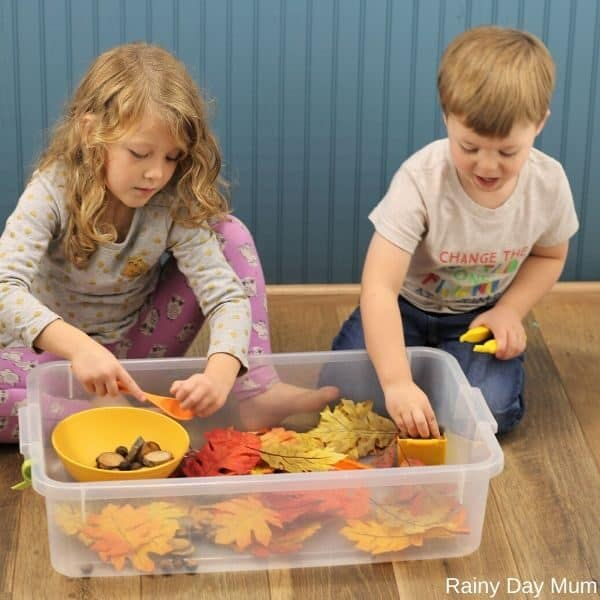 children playing together in the sensory bin