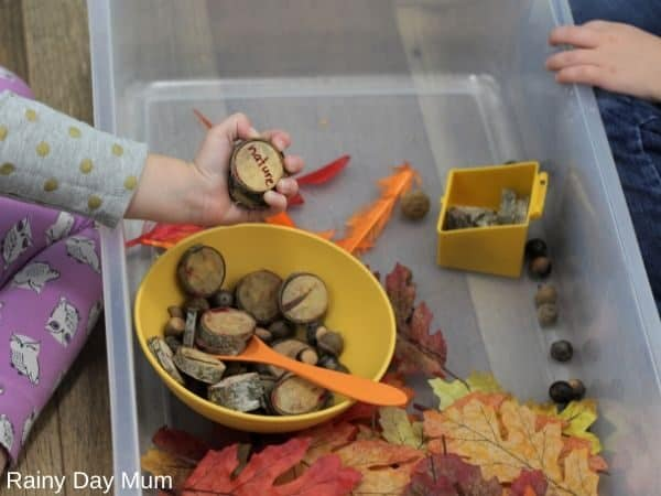 kids playing in a sensory bin using it to share what they are thankful for