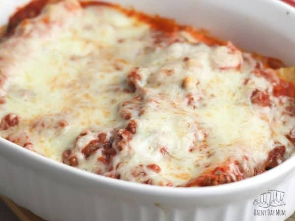 baked beef cannelloni with melted cheese in the baking dish ready for serving