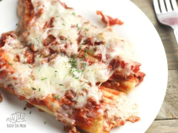 beef cannelloni on a white plate ready for dinner