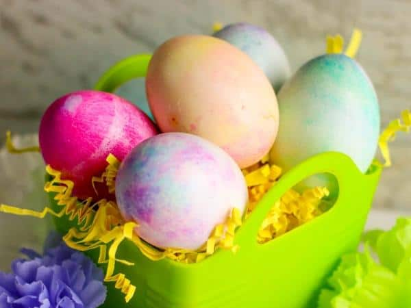 basket of marbled easter eggs you can make with toddlers and preschoolers