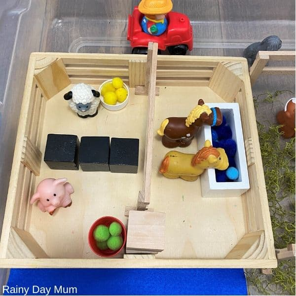 Fisher price little people farm animals being used in the sensory bin