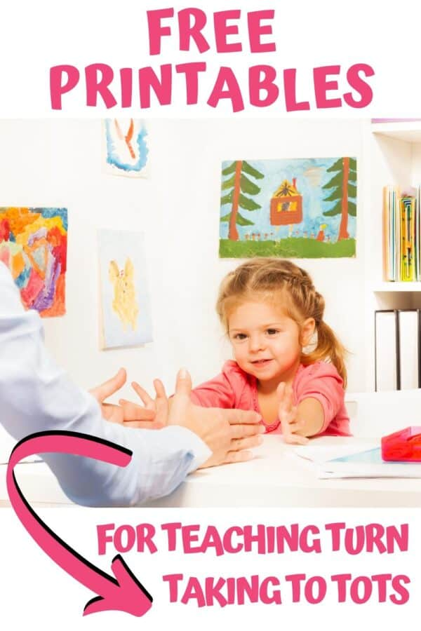 toddler playing with an adult taking turns with free printable games to play together