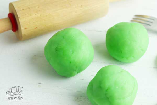 3 lime green playdough balls made with jell-o and a simple playdough recipe