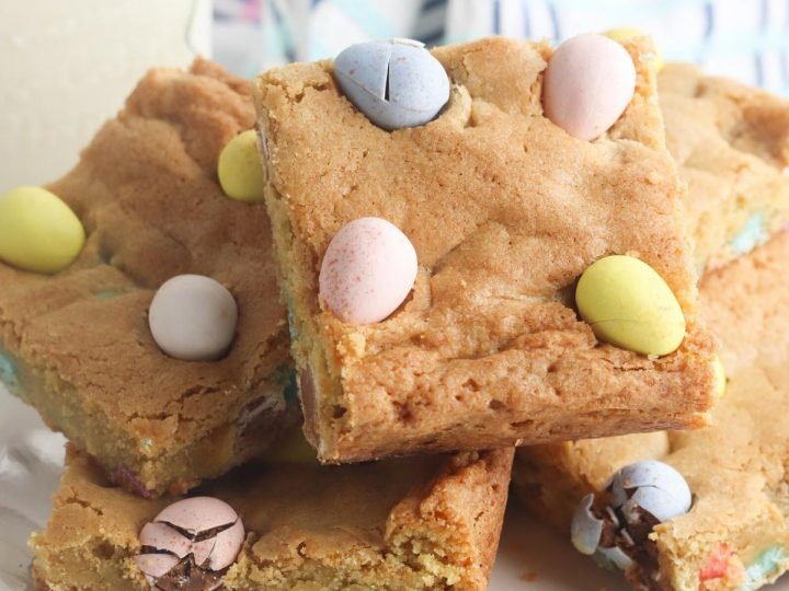 Delicious Easter Blondie bars with chocolate chips and Cadbury's mini-Eggs
