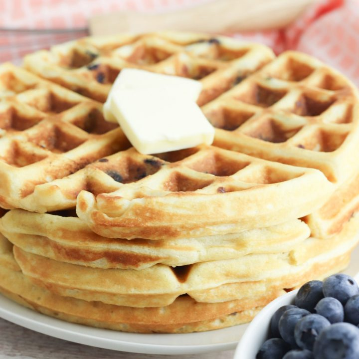 delicious blueberry waffles ready for breakfast with a knob of butter on top