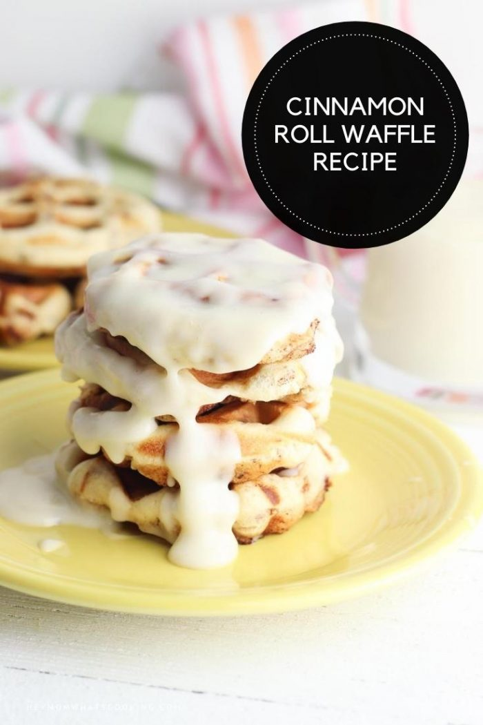 cinnamon roll dough waffles on a plate with white frosting on top