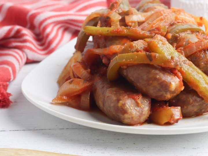 sausage casserole on a white plate cooked at home in the slow cooker
