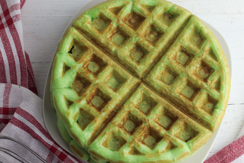 plate with waffles stacked on