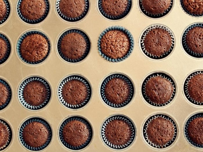 chocolate cupcakes in a cupcake tin out of the oven