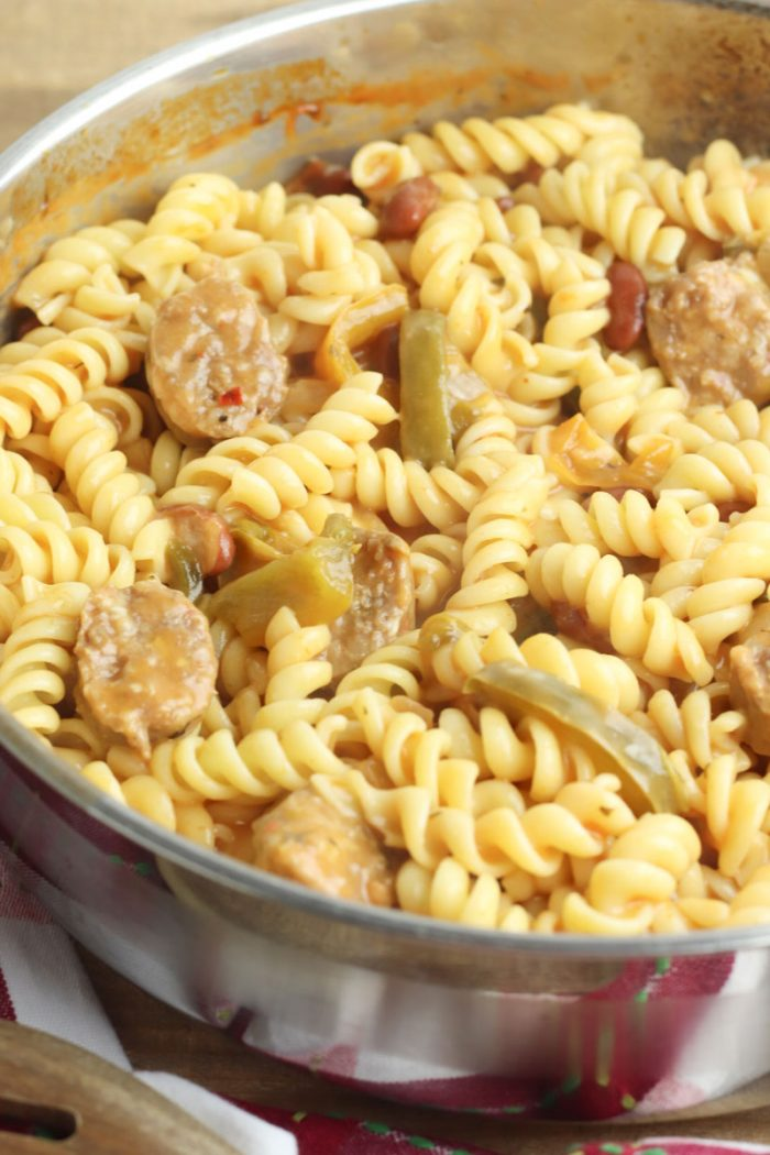 pasta with sausage in a pan ready to be served for school night dinner