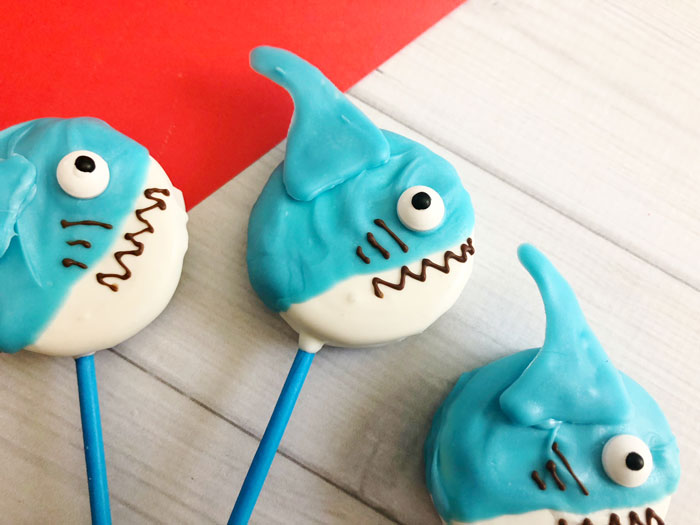 finished shark oreo pops ready for a kids under the sea party