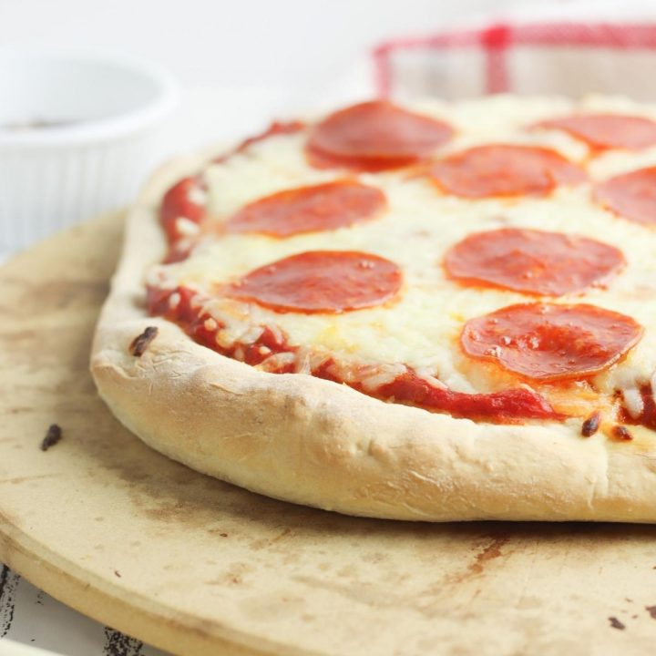 pepperoni pizza with homemade dough on a pizza stone