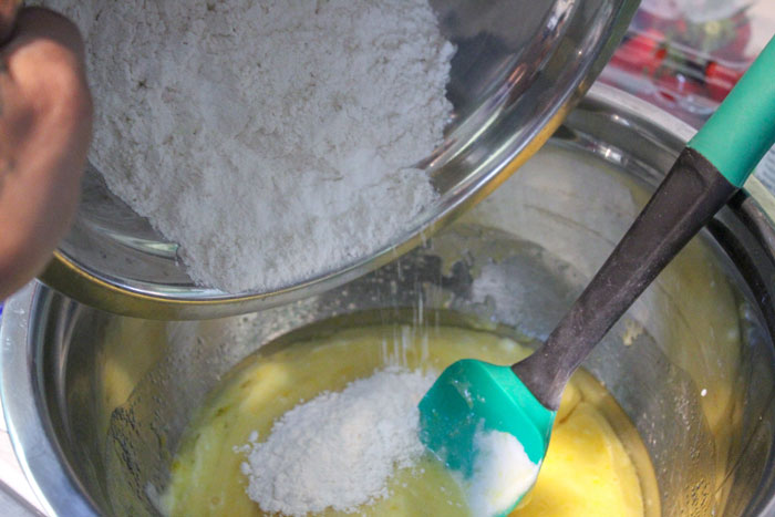 adding the dry and wet ingredients for making cakes together