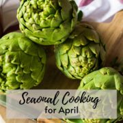 artichoke hearts on a wooden chopping board in a pile. The text overlay reads Seasonal Cooking for April