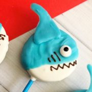a simple diy cookie pop for an under the sea party. With blue and white plus gills and mouth this oreo popsicle is a perfect shark shape for any party