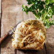 a celeriac root fresh from the vegetable box on the kitchen table with a knife behind ready to cook with but what!