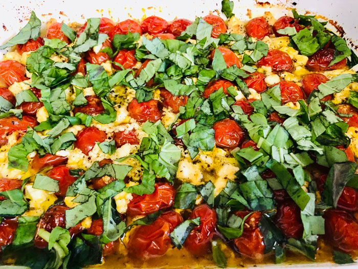 fresh basil chopped and added to the top of the baked feta and tomatoes for tik tok pasta
