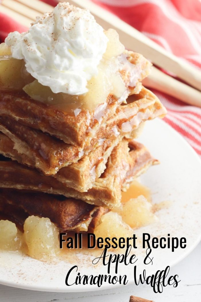 Fall dessert recipe apple and cinnamon waffles pinterest image with text showing a stack of waffles with apple pie filling and whipped cream from above on a plate