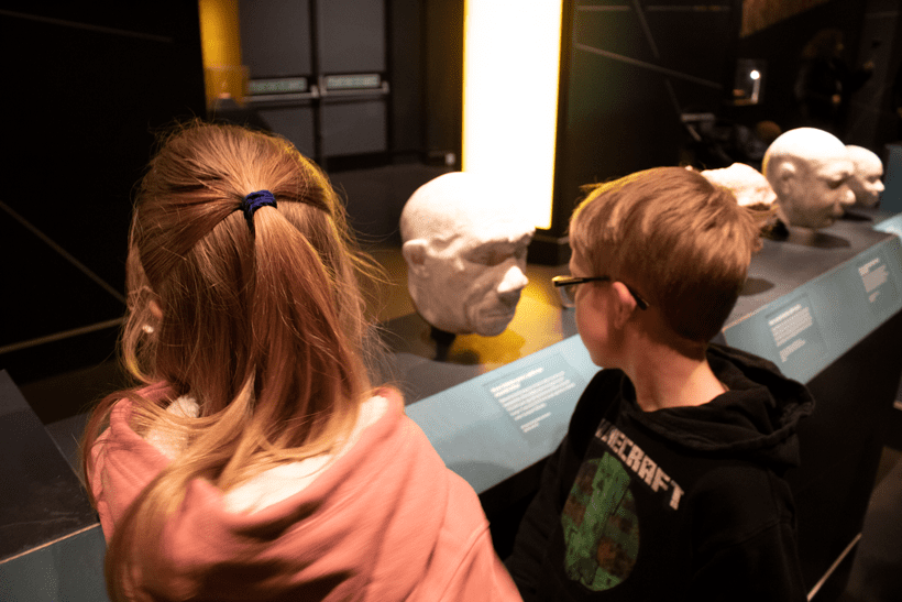 kids viewing the evolution of humans at the exhibit in the natural history museum london