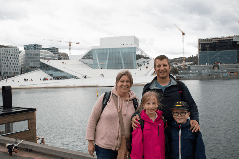 travelled so far family standing in front of the Opera House in Oslo