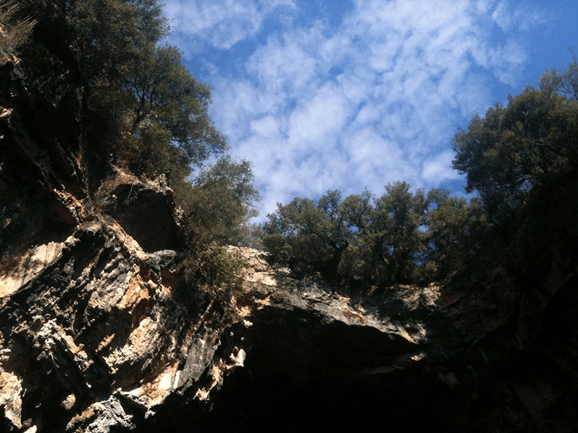 view looking up at the hole opened by the 1953 earthquake on kefalonia from the boat on Melissani Lake