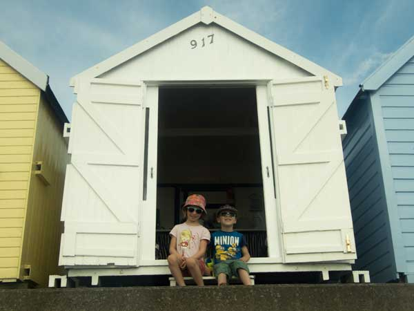 kids sitting on beach hut steps Felixstowe