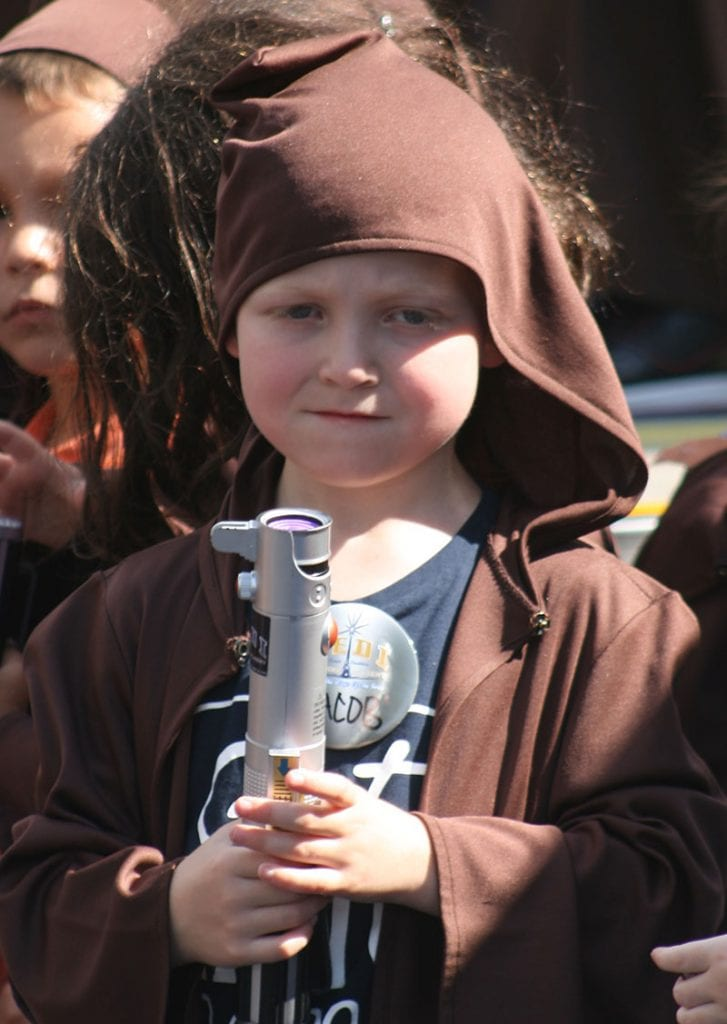 child with light sabre at Jedi Training